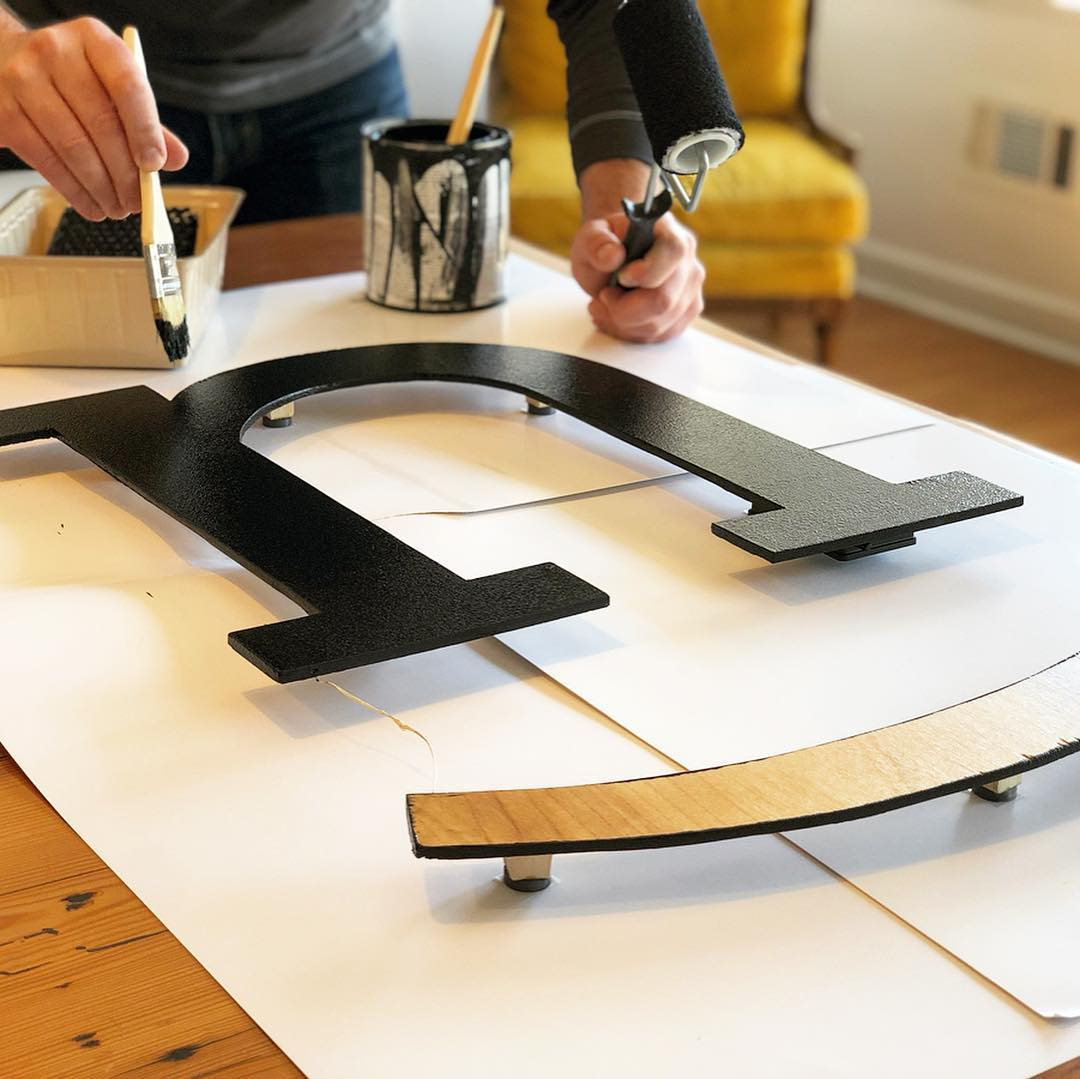 Painting our wooden logo black