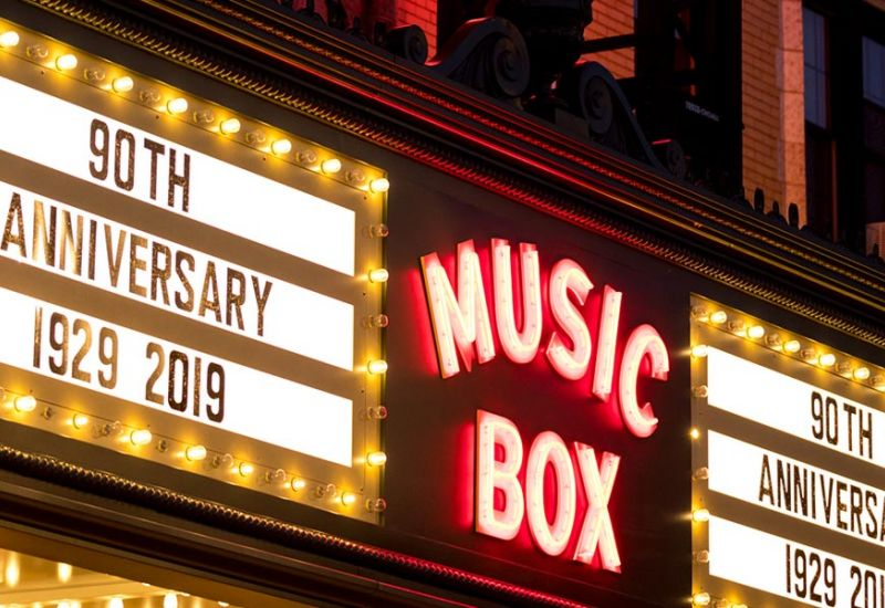 Chicago's Music Box Theatre marquee lit up at night reading: 90th Anniversary 1929 – 2019