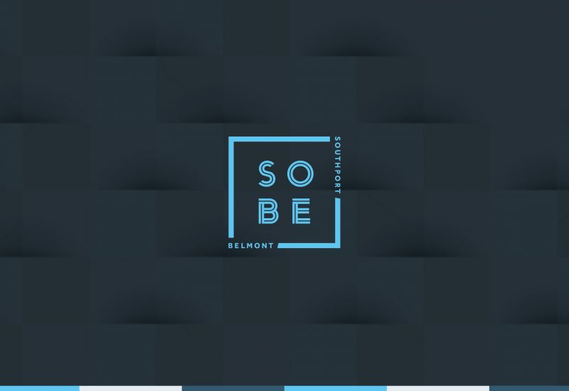 SOBE logo featuring its location at the intersection of Chicago's Southport and Belmont avenues.